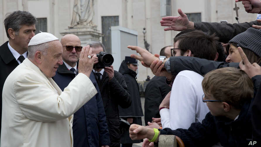 Pope Francis blesses faithful during his weekly general audience, in St. Peter's Square, at the Vatican, Feb. 14, 2018.