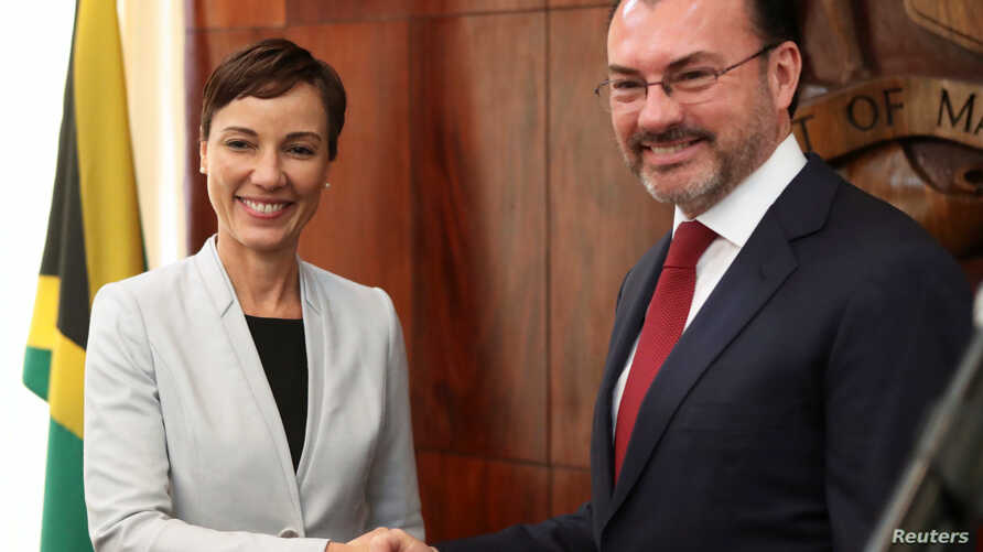 Jamaica's Foreign Minister Kamina Johnson-Smith and her Mexican counterpart Luis Videgaray shake hands after a joint news conference in Kingston, Jamaica March 6, 2018.