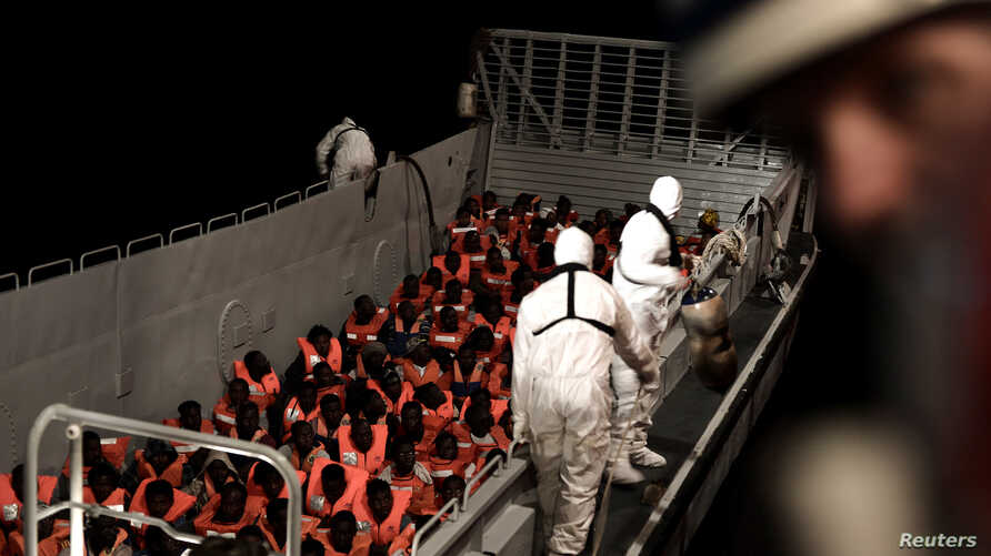 Migrants are rescued by staff members of the MV Aquarius, a search and rescue ship run in partnership between SOS Mediterranee and Medecins Sans Frontieres in the central Mediterranean Sea, June 10, 2018.  (Karpov/handout via Reuters)