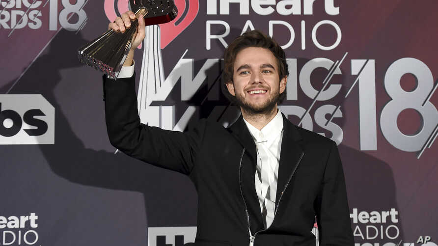 "Zedd poses in the press room with the award for dance song of the year for ""Stay"" at the iHeartRadio Music Awards at The Forum, March 11, 2018, in Inglewood, Calif."