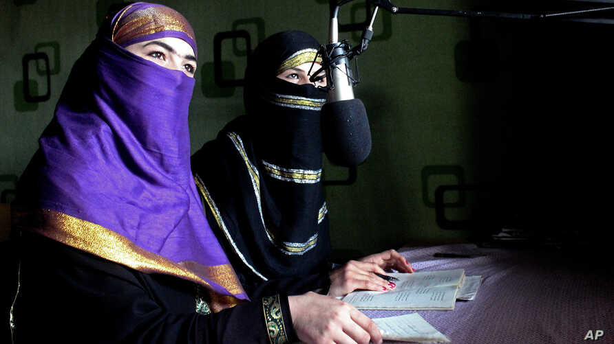 Broadcasters of Radio Shaesta prepare themselves to go on-air, in Kunduz, Afghanistan, March 4, 2016.
