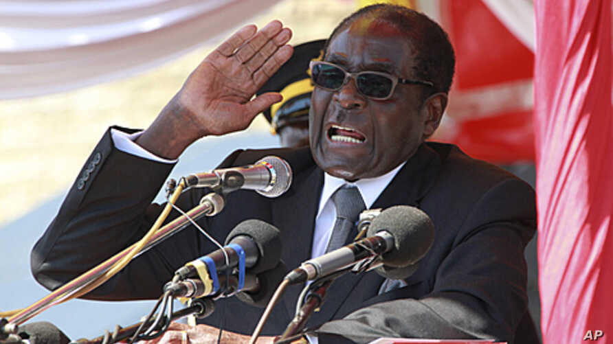Zimbabwean President Robert Mugabe addresses supporters in Harare, July 20, 2011