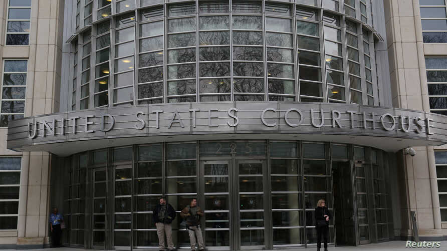 FILE - People stand outside a federal courthouse in New York City.