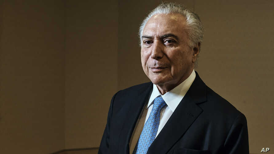 Brazil's President Michel Temer poses for a portrait at Four Seasons Hotel during the 73rd session of the United Nations General Assembly, Sept. 24, 2018, in New York.