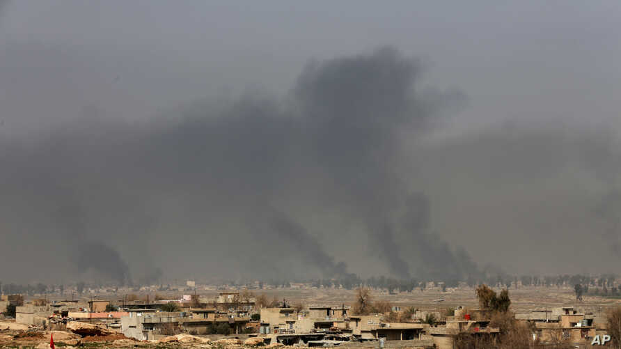 Smoke rises after an airstrike by U.S.-led coalition warplanes during fighting on the western side of Mosul, Iraq, Feb. 27. 2017. A senior Iraqi police commander said Monday that troops have taken control of the western side of a key bridge in Mosu.