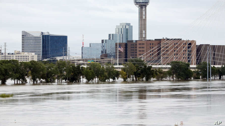The rain-swollen Trinity River is seen with the city skyline in the background in Dallas, Texas, Oct. 24, 2015. Southeast Texas was bracing for heavy rain late Saturday and into Sunday as the remnants of Hurricane Patricia combined with a powerful st
