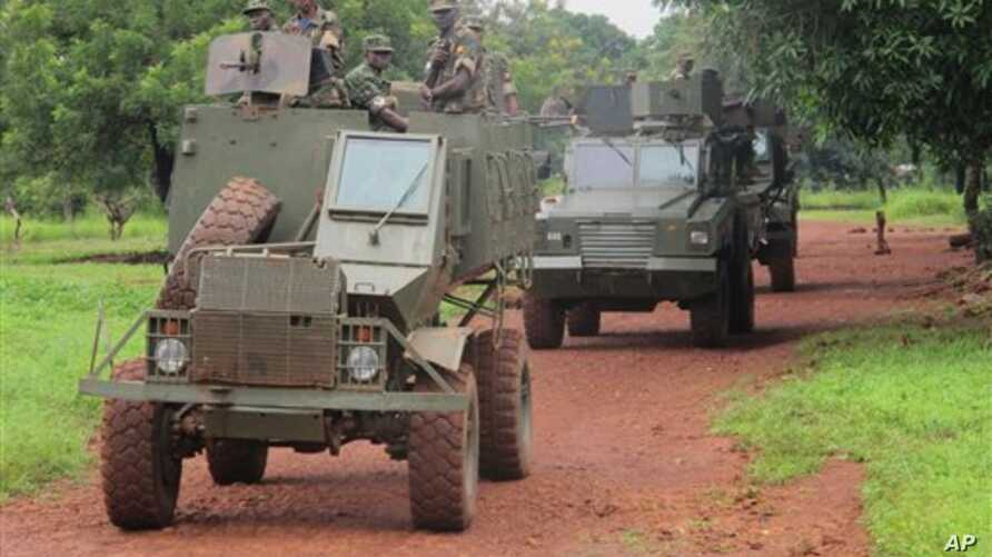 In this June 25, 2014 photo, Ugandan troops patrol the town of Zemio in Central African Republic, where they are hunting down the fugitive members of the Lord's Resistance Army rebel group. (AP Photo/Rodnet Muhumuza)