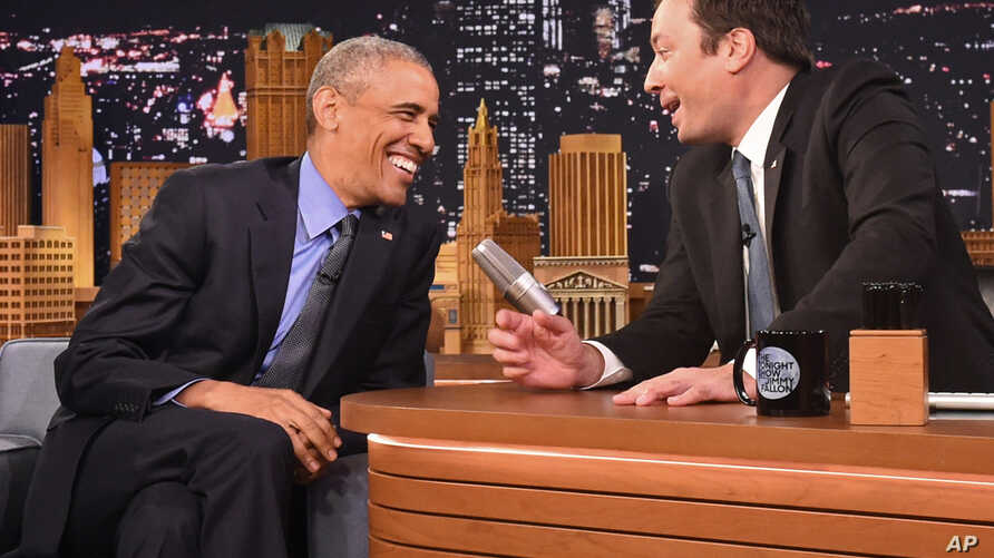 """President Barack Obama, left, shares a laugh with host Jimmy Fallon on the set of the """"The Tonight Show Starring Jimmy Fallon,"""" at NBC Studios in New York, Wednesday, June 8, 2016."""