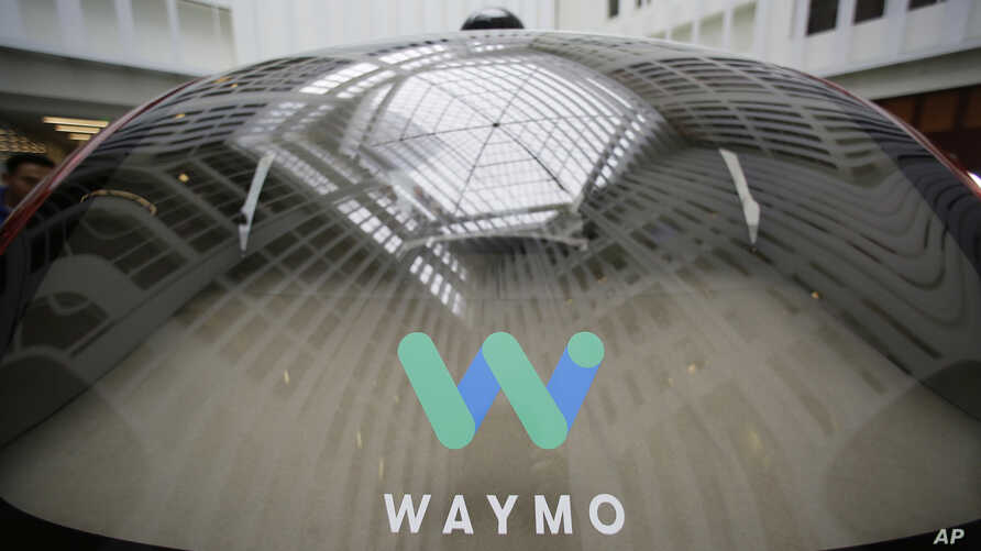 In this Dec. 13, 2016, file photo, a skylight is reflected in the rear window of a Waymo driverless car during a Google event in San Francisco. Google's robotic car spin-off Waymo is poised to become the first to test fully driverless vehicles on Cal