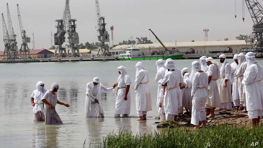Members of the Sabean Mandaeans, a pre-Christian sect that follows the teachings of John the Baptist,  take part in a bathing ritual during the Baptism Festival, on the banks of the Shatt al-Arab waterway in Basra, 340 miles (550 kilometers) southeas