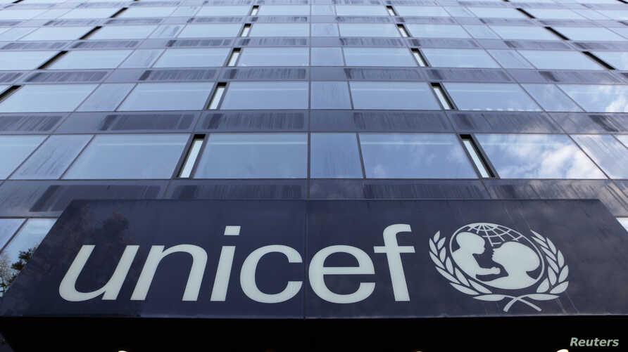 FILE - The UNICEF logo is pictured on a building in Geneva.