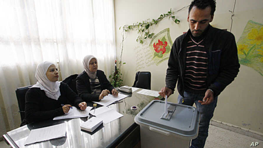A man casts his vote in Damascus, Syria, December 12, 2011.