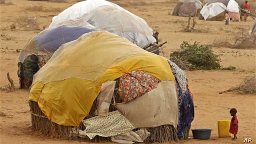 A child stands in front of her home at a refugee camp in Dadaab, Kenya, Thursday, Aug 4, 2011.