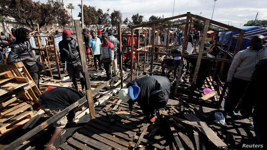 African migrants build a makeshift house after their houses burned, on the outskirts of Casablanca,  Morocco, Oct. 29, 2018.