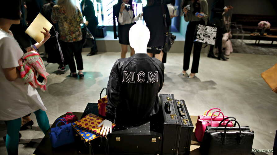 Products of MCM are displayed during an opening ceremony for a MCM flagship store in Seoul, South Korea, April 21, 2016.