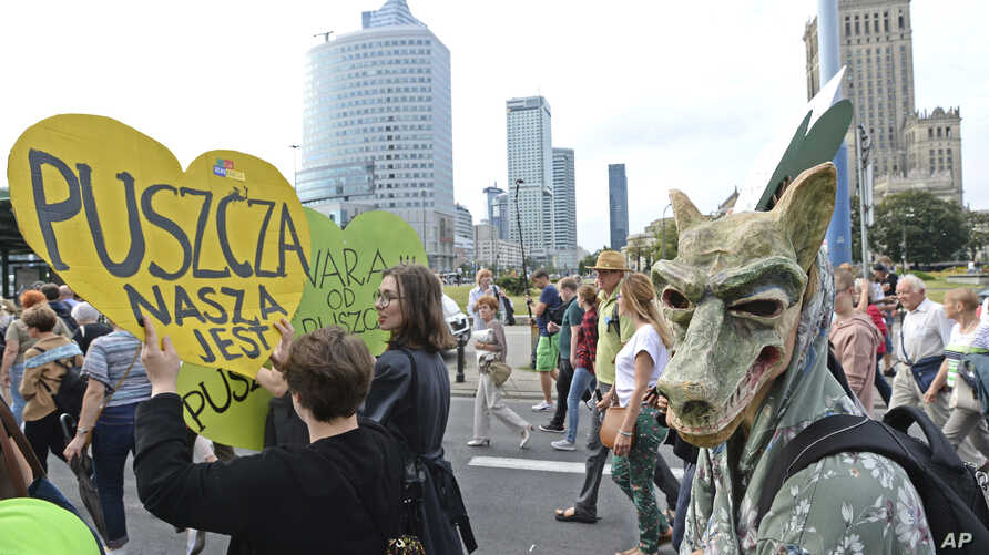 """Protesters march with placard reading """"The Forest is Ours"""", demanding a stop to massive logging in the Bialowieza forest, one of Europe's last virgin woodlands, in Warsaw, Poland, June 24, 2017."""