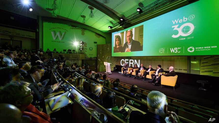 English computer scientist Tim Berners-Lee, 3rd left on the podium, best known as the inventor of the World Wide Web, attends an event at the CERN in Meyrin near Geneva, Switzerland, March 12, 2019 marking 30 years of World Wide Web.