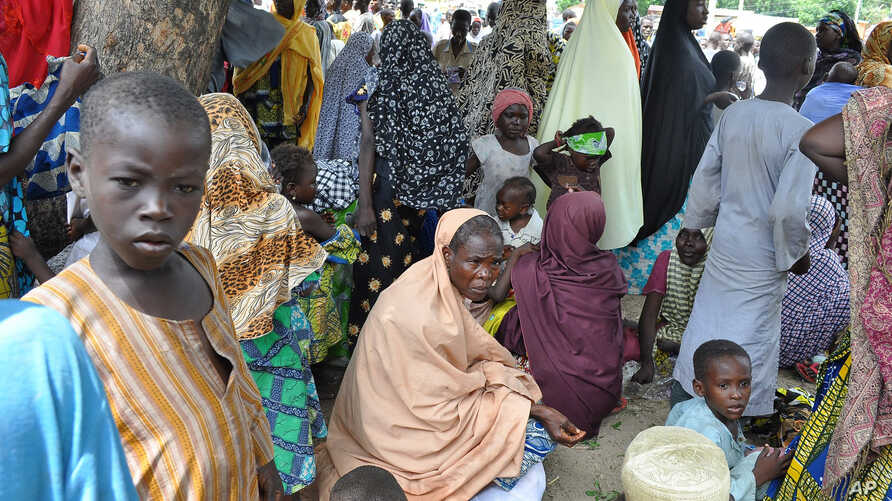 Refugees fleeing Boko Haram attacks on the town of Bama take shelter at a school in Maiduguri, Nigeria, Sept. 3, 2014.