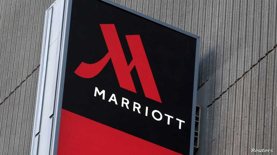 FILE - Signage for the New York Marriott Marquis is seen in Manhattan, New York, Nov. 16, 2015. Marriott International bought Starwood Hotels and Resorts for $13.6 billion on Monday to create the world's biggest hotel chain.