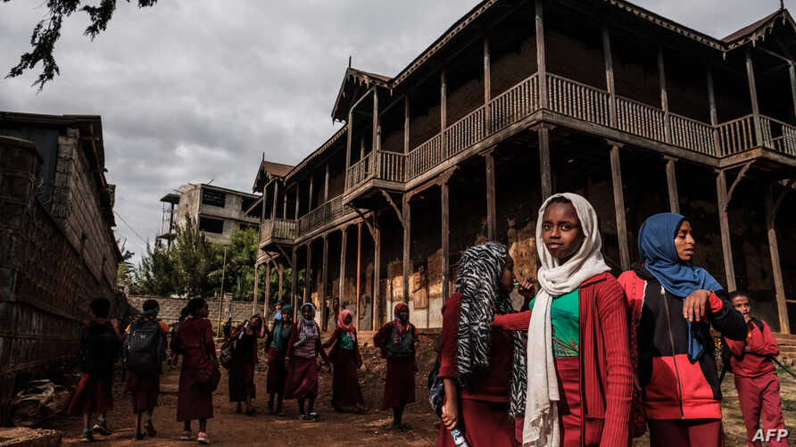 FILE - Students gather in the courtyard of the Sheik Ojele palace, which was built in 1890 and influenced by Indo-Islamic architectural design, and currently used as a residence combined with a school, in Addis Ababa, Nov. 29, 2018.
