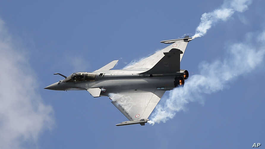 FILE - A Rafale single-seat jet aircraft flies during its demonstration at the Paris Air Show, in Le Bourget airport, north of Paris, June 19, 2015.
