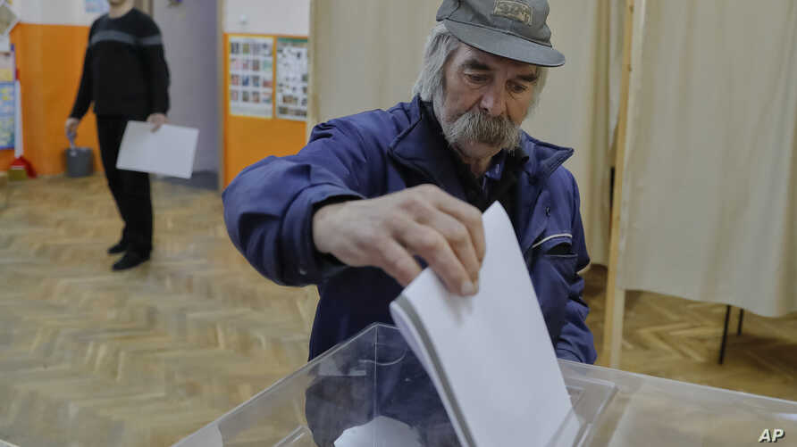 A man casts his vote, in Sofia, Bulgaria,  March 26, 2017.