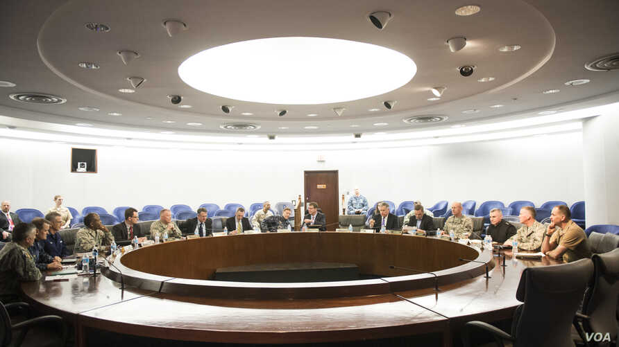 Secretary of Defense Ash Carter meets with Adm. Mike Rogers and his senior staff members at the National Security Agency headquarters on Fort Meade, Md., March 13, 2015.