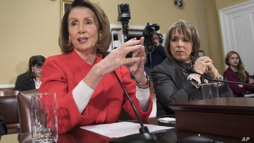 House Minority Leader Nancy Pelosi, D-Calif., and Hispanic Caucus Chair Rep. Michelle Lujan Grisham, D-N.M., right, appear before the House Rules Committee asking to add protections to the government funding bill for immigrants brought to the U.S. il