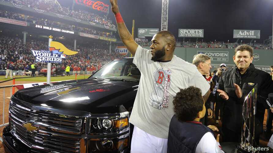 Oct 30, 2013; Boston, MA, USA; Boston Red Sox designated hitter David Ortiz waves to the crowd after being named series MVP after game six of the MLB baseball World Series against the St. Louis Cardinals at Fenway Park. The Red Sox won 6-1 to win the