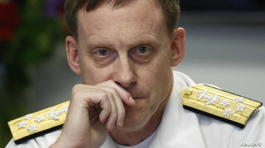 NSA Director Adm. Michael Rogers listens at a Reuters CyberSecurity Summit in Washington, May 12, 2014.