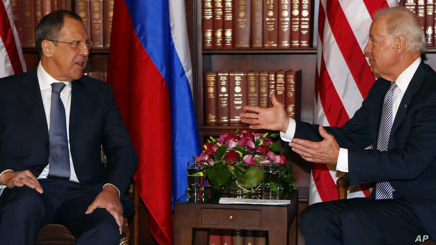 Russia's Foreign Minister Sergei Lavrov and U.S. Vice-President Joe Biden (R) meet for bilateral talks during the 49th Conference on Security Policy in Munich, February 2, 2013.
