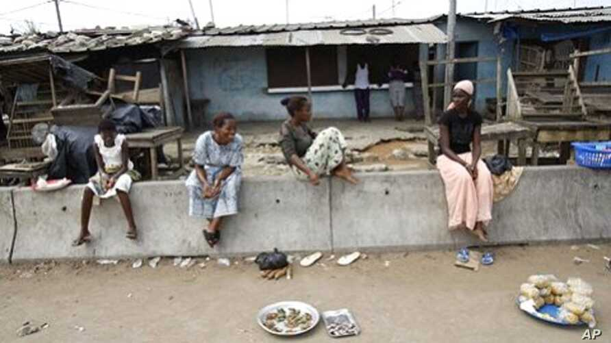 Market vendors display their meager stock of available goods at a street market in the Youpougon neighborhood of Abidjan, April 9, 2011