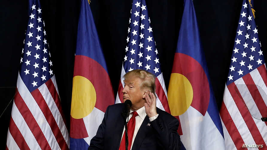 U.S. Republican presidential nominee Donald Trump puts his hand to his ear as he speaks at a campaign rally in Pueblo, Colorado, Oct. 3, 2016.