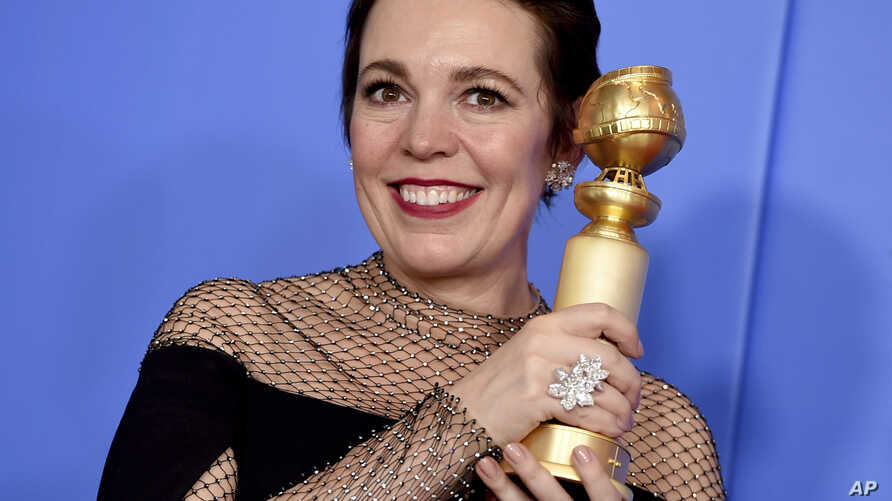 """FILE - Olivia Colman poses in the press room with the award for best performance by an actress in a motion picture, musical or comedy for """"The Favourite"""" at the 76th annual Golden Globe Awards at the Beverly Hilton Hotel in Beverly Hills, Calif., Jan"""