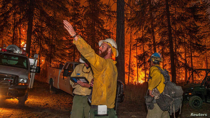 Firefighters prepare to battle the Wolverine wildfire near Chelan, Washington, in this U.S. Forest Service picture taken Aug. 16, 2015.