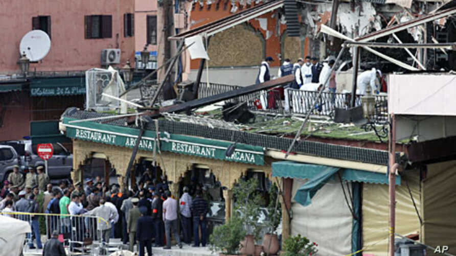 Investigators work at the scene of an explosion which rocked the Argana cafe in Marrakesh's Jamaa el-Fnaa square,  April 28, 2011