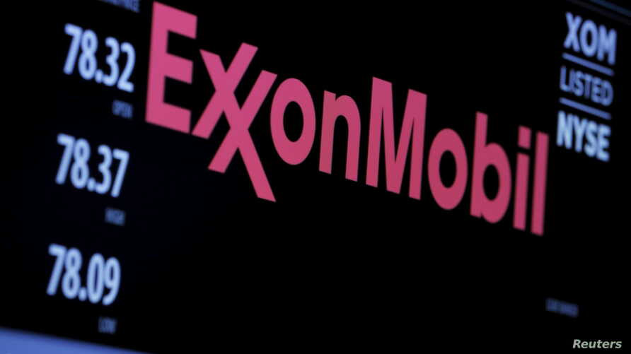 FILE - The logo of Exxon Mobil Corporation is shown on a monitor above the floor of the New York Stock Exchange in New York, Dec. 30, 2015.