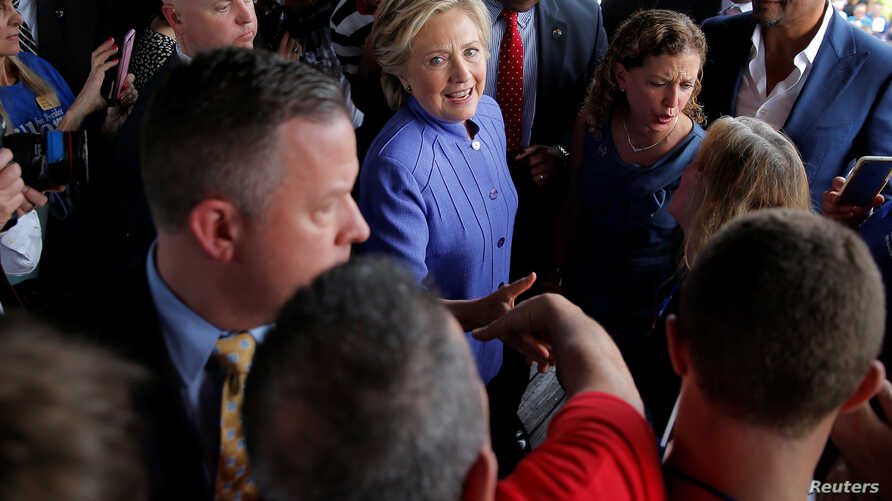 U.S. Democratic presidential candidate Hillary Clinton greets supporters outside a campaign rally at the Manor Complex in Wilton Manors, Florida, Oct. 30, 2016. News of additional emails the FBI uncovered from when she was secretary of state has appa