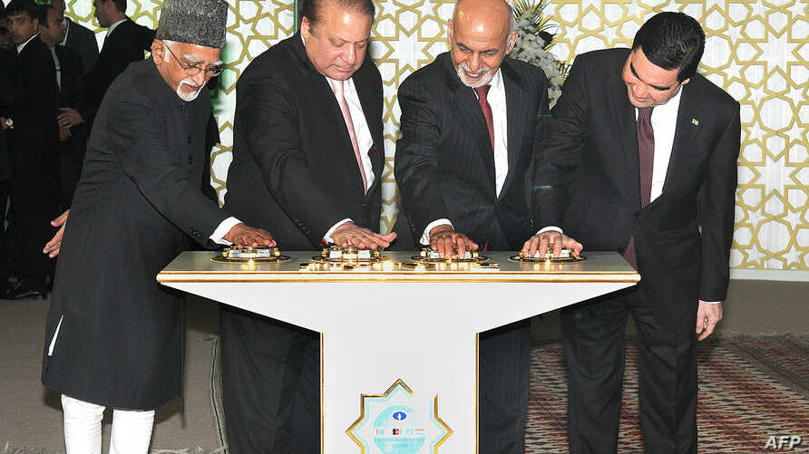 In this photograph released by the Press Information Bureau (PIB) on December 13, 2015, Indian Vice President, Hamid Ansari (L), along with President of Turkmenistan, Gurbanguly Berdimohamedov (R), President of Afghanistan, Ashraf Ghani (2R) and Prim