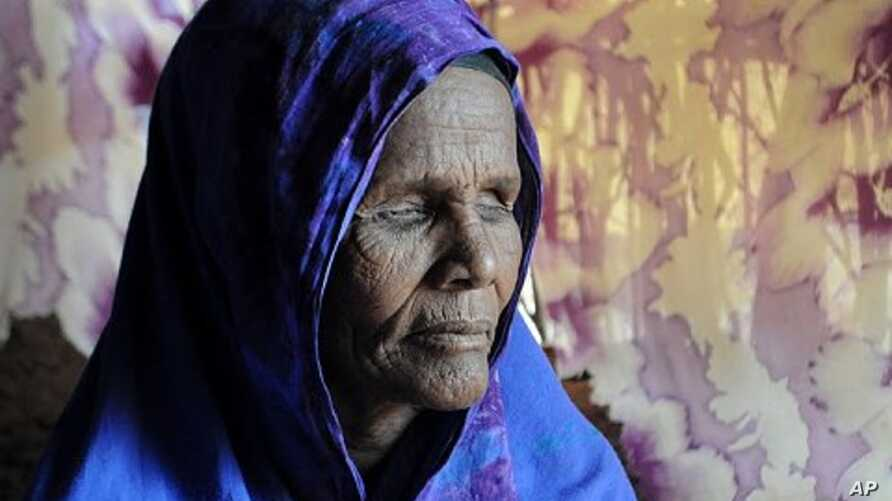 Ibado Mahmud, 50, at the Dagahaley camp in Dadaab, Kenya. Mahmud had her eyes removed by Ethiopian troops before travelling to the camps. Doctors believe she is suffering from post-traumatic stress disorder.