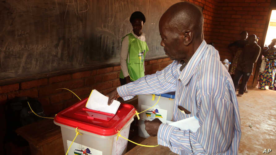 A man casts his ballot during elections in Bangui, Central African Republic, Dec. 30, 2015.