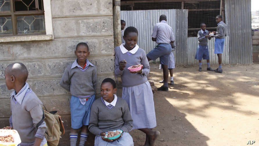 Pupils at Mariakani Primary School in Nairobi, Kenya, enjoy their lunchbreak, July 27, 2015.