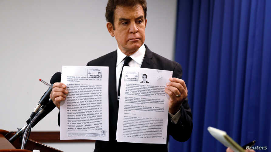 Honduran opposition candidate Salvador Nasralla displays documents filed with Honduran election officials during a news conference in Washington, U.S., Dec.19, 2017.
