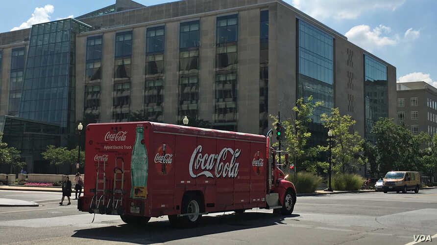 A Coca-Cola delivery truck drives past an office building in Washington, DC. (Photo: Diaa Bekheet)