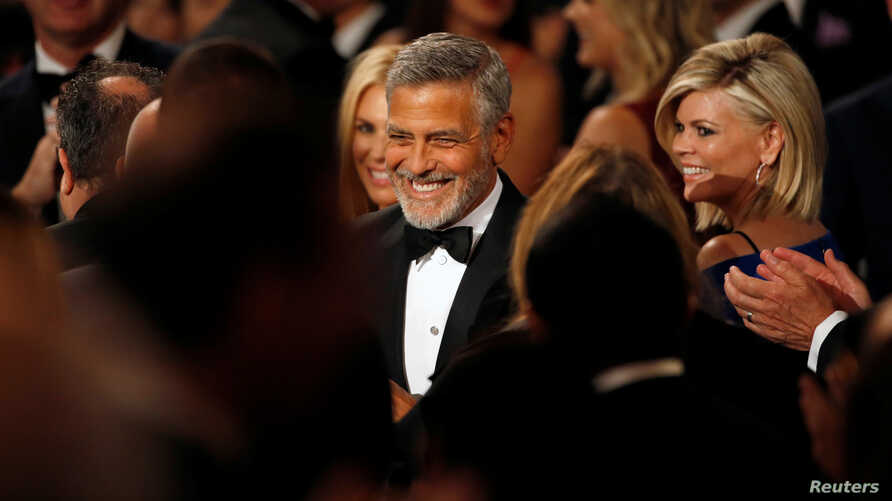 Actor George Clooney walks the floor at the 46th AFI Life Achievement Award Gala in Los Angeles, California, June 7, 2018.