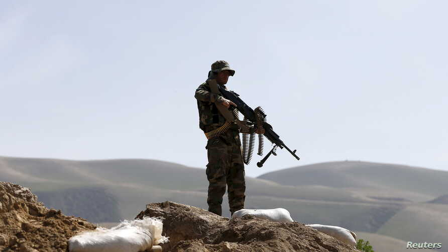 FILE - An Afghan National Army (ANA) soldier keeps watch during a patrol in Dand Ghori district of Baghlan province, Afghanistan. March 15, 2016.