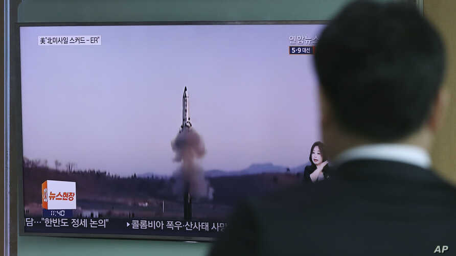 "A man watches a TV report about North Korea's missile firing with file footage, at Seoul Train Station in Seoul, South Korea, April 6, 2017. The letters read ""U.S., North, Scud missile-ER."""