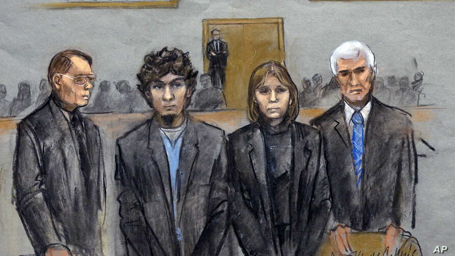 In this courtroom sketch, Dzhokhar Tsarnaev, second from left, is depicted standing with his defense attorneys William Fick, left, Judy Clarke, second from right, and David Bruck, right, as the jury presents its verdict, April 8, 2015.