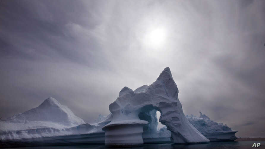 FILE - An iceberg is seen off Ammassalik Island in Eastern Greenland. A leaked government document, its authenticity confirmed by the Danish governemnt in 2011, shows Denmark plans to lay claim to the North Pole and other areas in the Arctic, where m