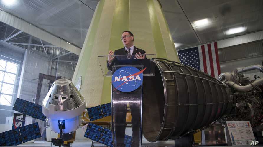 In his image released by NASA, acting NASA Administrator Robert Lightfoot discusses the fiscal year 2019 budget proposal during a State of NASA address Monday, Feb. 12, 2018 at NASA's Marshall Space Flight Center in Huntsville, Alabama.